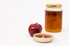 Red apple and jar of honey bowl of honey isolated on a white bac Stock Photo