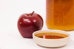 Red apple and jar of honey bowl of honey isolated on a white bac Royalty Free Stock Photography