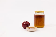 Red apple and jar of honey bowl of honey isolated on a white bac Stock Image