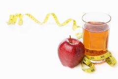 Red apple and jiuce with measuring tape Royalty Free Stock Images