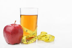 Red apple and jiuce with measuring tape Stock Photo
