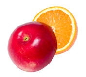 Red apple and juicy orange. Halves  of red ripe apple and juicy orange. Isolated on white background Stock Photo