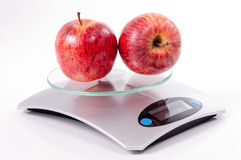 Red apple on kitchen scale Stock Photo