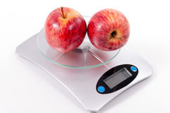 Red apple on kitchen scale Royalty Free Stock Photo