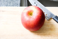 Red apple with knife Royalty Free Stock Photos