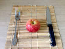 Red apple and knife on wooden table closeup. Red apples on a wooden floor with a knife rests Royalty Free Stock Photography
