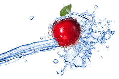 Red apple with leaf and water splash Royalty Free Stock Images