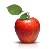 Red apple with leaves and water drops Stock Photo