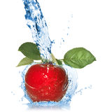Red apple with leaves and water splash isolated Stock Images