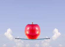 Red apple levitation on the glass ship Royalty Free Stock Images