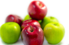 Red apple   among lots of green and red apples isolated white ba Stock Photography