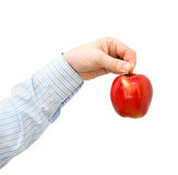 Red apple in a man's hand Royalty Free Stock Images