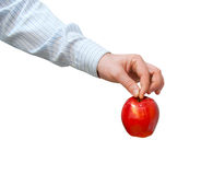 Red apple in a man's hand Stock Images