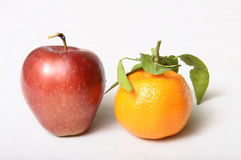 Red apple and Mandarin Royalty Free Stock Images