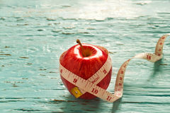 Red apple and measure in pastel vintage color tone on blue wooden Stock Photo