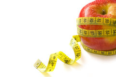 Red apple and measure tape Stock Image
