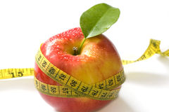 Red apple and measure tape Royalty Free Stock Photos