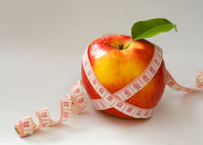 Red apple and measure tape Stock Photography