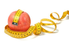 Red apple and measure tape Royalty Free Stock Image