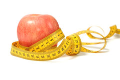 Red apple and measure tape Stock Photo
