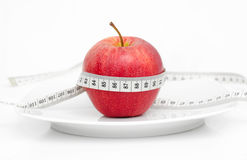 Red Apple with measure tape. On white Stock Photo