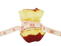 Red apple and a measure tape Stock Image