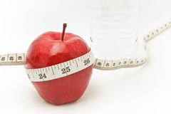 Red apple and measure tape. Stock Image