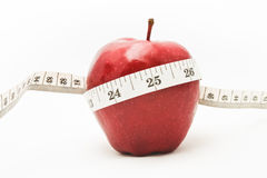 Red apple and measure tape. Royalty Free Stock Photo