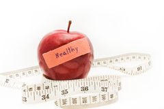 Red apple and measure tape. Royalty Free Stock Images