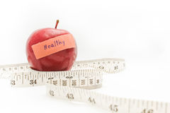 Red apple and measure tape. Royalty Free Stock Photography