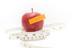 Red apple and measure tape. Stock Photo