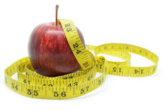 Red apple with measure tape Royalty Free Stock Images