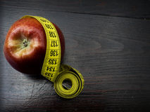 Red apple with measurement Stock Photography