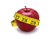 Red apple and measurement tape Royalty Free Stock Photo