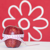 Red apple and measurement tape Stock Photos