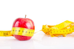 Red apple with measurement  on white Royalty Free Stock Photo