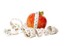 Red Apple  with measuring tape Royalty Free Stock Image