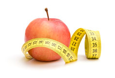 Red apple and measuring tape Royalty Free Stock Photo