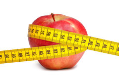 Red apple and measuring tape Royalty Free Stock Photos