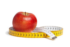 Red apple and measuring tape Stock Photo