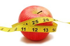 Red apple and measuring tape Stock Image