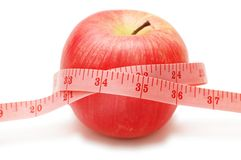 Red apple and measuring tape Royalty Free Stock Photography