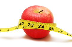Red apple and measuring tape. Isolated on white Royalty Free Stock Photo