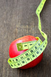 Red apple with measuring tape. Stock Photography