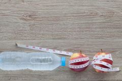 Red apple  and measuring tape.The concept of weight control Lose Royalty Free Stock Image