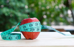 Red Apple and measuring tape. Red Apple fruit and measuring tape Stock Photo