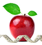 Red apple with measuring tape Royalty Free Stock Photos