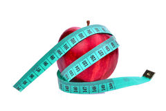 Red apple with measuring tape isolated on white Stock Photos