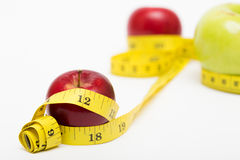 Red apple and measuring tape Royalty Free Stock Image