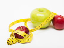 Red apple and measuring tape Stock Photography